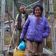 Two Nepalese ladies cross the bridge at Koshigaun village between Lukla and Phakding
