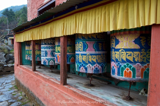 Prayer wheels between Koshigaun village and Phakding