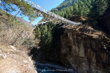 The high suspension bridge between Jorsalle and Namche Bazaar.