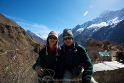 Stuart and Suit Yoo with the wonderful vista behind of Mount Everest, Taboche, Nuptse, Lhotse, Lhotse Shar and Ama Dablam.