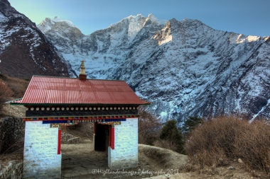 Prayer wheels at Tengboche with Kangtega in the background.
