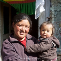 Smiling mother and baby at a small tea house between Phakding and Lukla.