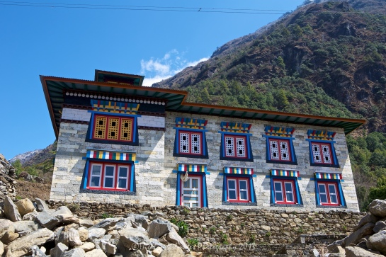 Colourful windows and doors on a house between Monjo and Lukla.