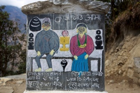 Inscribed stone close to Lukla on the final trek from Monjo.